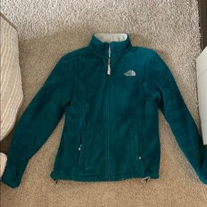 Teal fuzzy north face jacket